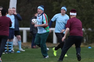 Anthony Albanese takes the ball at the annual NSW-QLD political State of Origin football game on the Senate oval of Parliament House in June 2018.