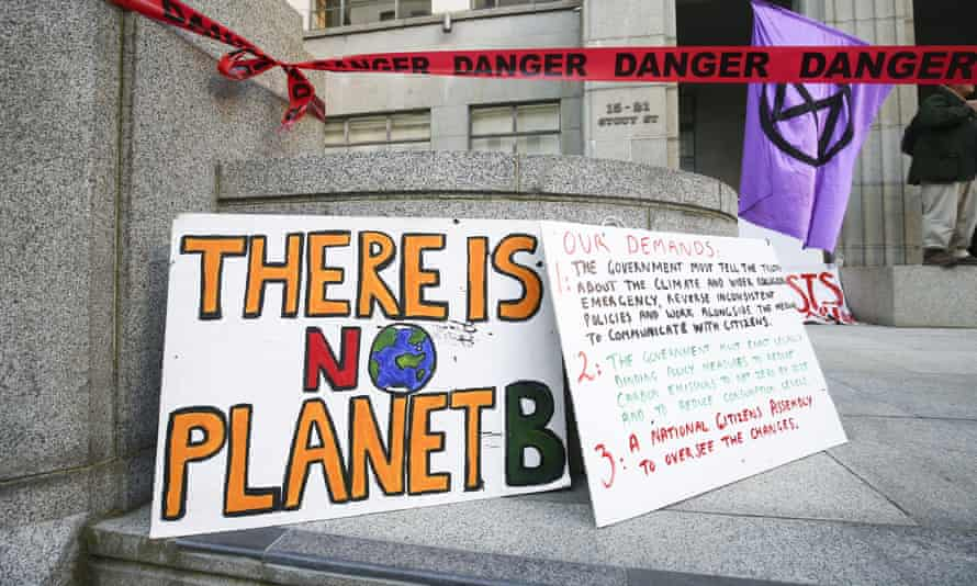 Signs on display during an Extinction Rebellion protest in October 2020