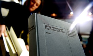 """(FILES) This file photo taken on January 08, 2016 shows a copy of an annotated version of Adolf Hitler's book """"Mein Kampf"""" prior to a press conference for its presentation in Munich, southern Germany, on January 8, 2016. The first reprint of Adolf Hitler's """"Mein Kampf"""" in Germany since World War II has proved a surprise bestseller, heading for its sixth print run, its publisher said on January 3, 2017. / AFP PHOTO / Christof STACHECHRISTOF STACHE/AFP/Getty Images"""