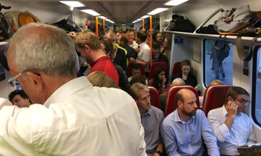 Commuters on a busy train.