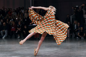 A model dances as she presents a creation from the Japanese designer Issey Miyake's spring-summer 2020 ready-to-wear collection at Paris fashion week