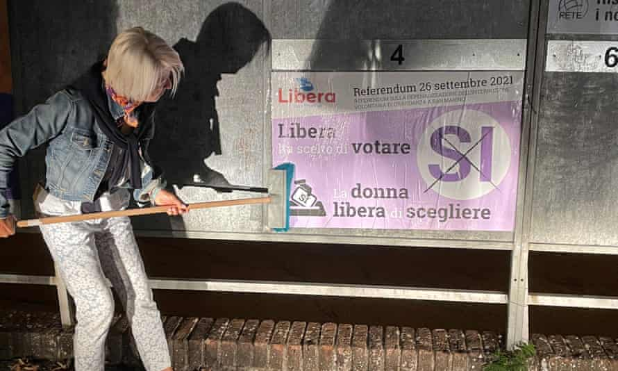 Dr. Francesca Nicolini puts up a pro-abortion poster ahead of the abortion referendum in San Marino.