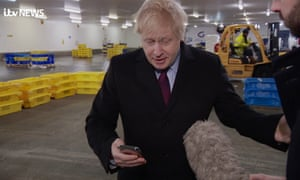 Boris Johnson being questioned about the picture of the ill child sleeping on the floor of Leeds General Infirmary by an ITV journalist on Monday.