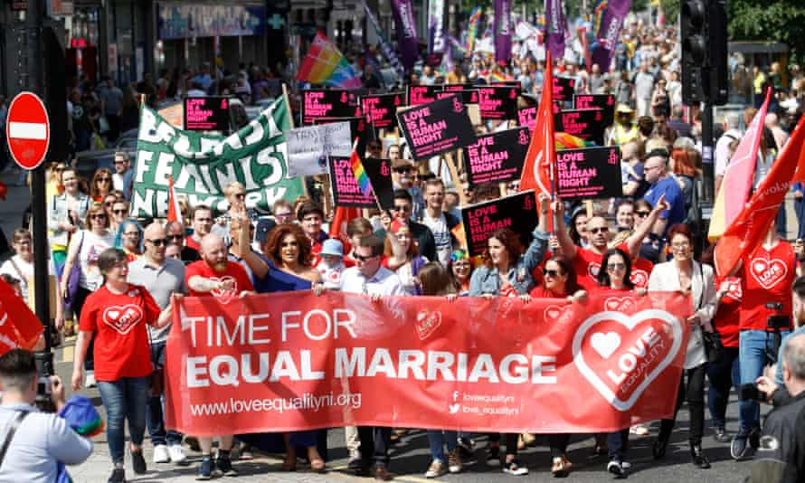 Activists campaigning for an end to Northern Ireland's ban on same-sex marriage march through Belfast city centre.