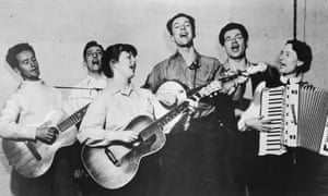 Seeger, centre with banjo, and the Almanac Singers, including Woody Guthrie, far left, in 1940.