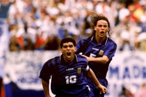 Maradona celebrates scoring Argentina's third goal with teammate Fernando Redondo against Greece in the 1994 World Cup in the US