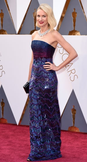 Naomi Watts is wearing Armani Prive with Swarovski crystal stripes. It's part glam rock, part midnight ocean vibes.
