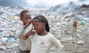 Two girls at the the rubbish dump in Eldoret known as California Barracks, where the police raid occurred.