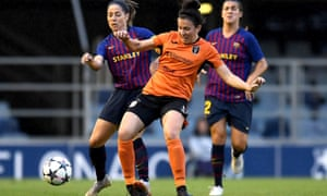Leanne Crichton of Glasgow City is challenged by Vicky Losada of Barcelona during the Women's Champions League in October 2018.