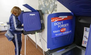 A woman casts her ballot on an electronic voting machine in the 2016 South Carolina Democratic presidential primary in Columbia, South Carolina.