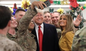 Donald and Melania Trump greet military personnel at Al Asad airbase in Iraq on 26 December.