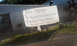 An image of a sheet with a protest sign written by asylum seekers held on Nauru.