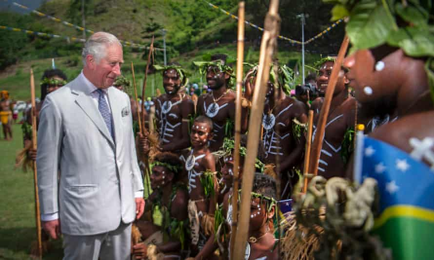 Prince Charles meets traditional dancers from the island of Guadalcanal at a community event focused on oceans at the Lawson Tama Stadium in Honiara.