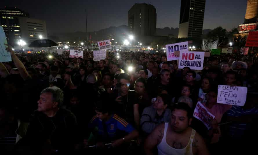 Demonstrators hold up placards during a protest at the Macroplaza in Monterrey on Thursday.