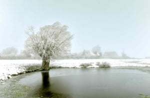 Snow and frost over a field in Godewaersvelde, northern France
