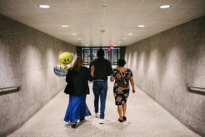 Marta and her daughter Julia walk out of the airport with her son José, who is developmentally delayed, after her arrived at Dulles international airport in Virginia.
