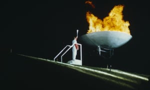 Sharman lights the Olympic flame at the Sheffield World Student Games in 1991.