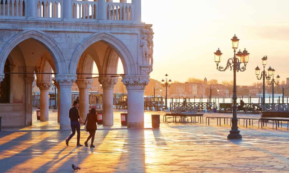A couple in St Mark's Square in Venice.