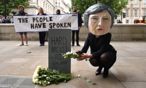 A protester from the global campaigning movement Avaaz articulates the growing view that Theresa May must soften her approach to Brexit after the Tories lost their Commons majority.