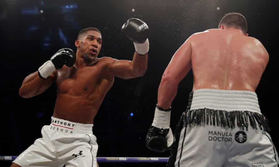 Anthony Joshua in action with Joseph Parker