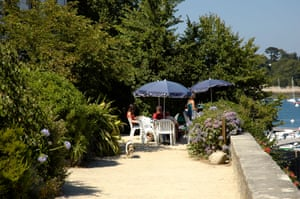Tables at Cafe de la Cale next to Odet river, Sainte-Marine, Finistere, Brittany