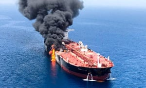 An oil tanker burns after the attack on 13 June in waters between Gulf Arab states and Iran.