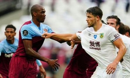 Burnley's James Tarkowski (right) gets to grips with West Ham's Angelo Ogbonna.