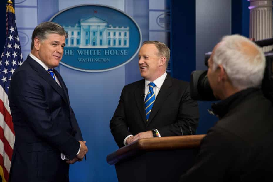 Sean Hannity speaks with then press secretary Sean Spicer at the White House on 24 January 2017.