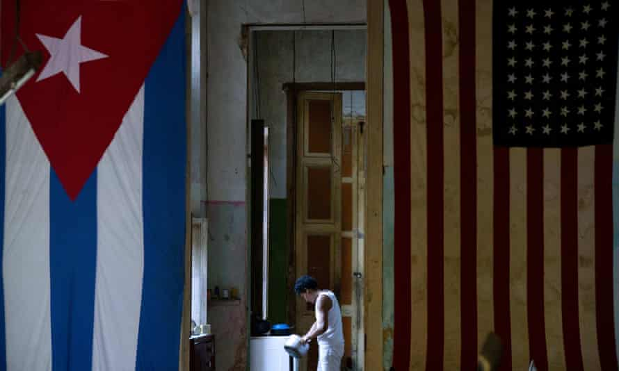 A US flag and a Cuban flag hang from the wall in the home of actor Armando Ricart in Havana, Cuba Tuesday.
