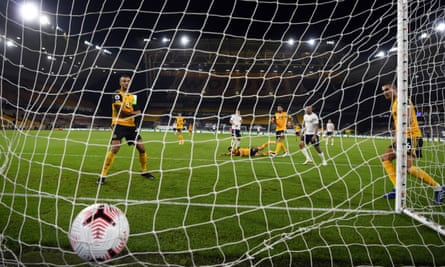 Wolves defenders can only look on as Phil Foden's shot hits their net to make it 2-0 to Manchester City in the first half.