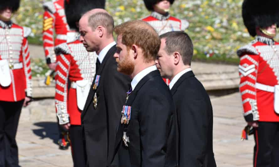 The Duke of Cambridge, Peter Phillips and the Duke of Sussex walk behind the Land Rover hearse.
