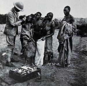 A medical officer taking a sample Buruma Island 1902 WT