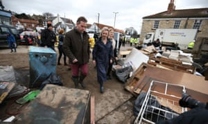 Liz Truss is given a tour of flood damage in Tadcaster.