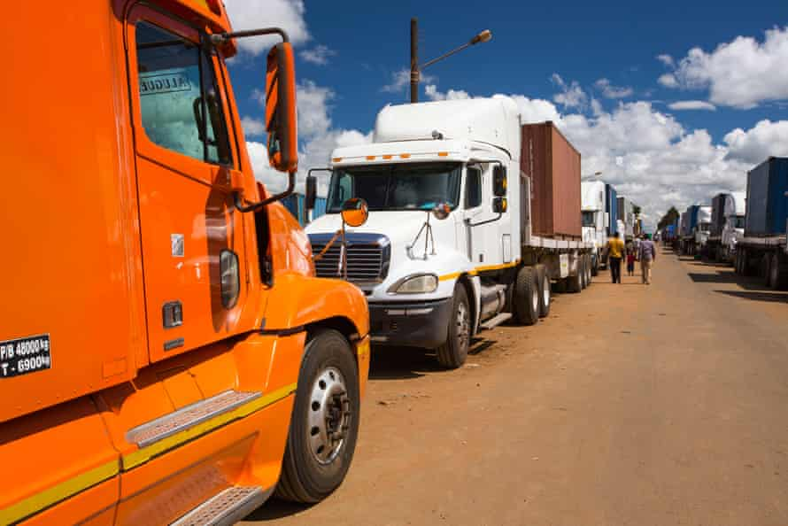 Trucks on Malawi's border wait to cross into Mozambique.