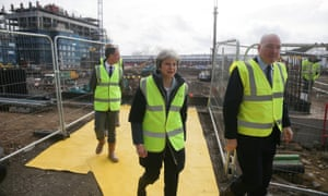 Theresa May visits a housing development in east London