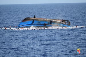 A boat overturns off the coast of Libya