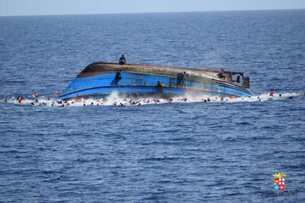Italian navy saves 550 refugees as smugglers' trawler
