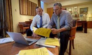 Tony Abbott and Joe Hockey look through budget papers.