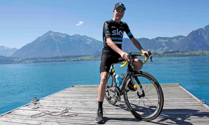Chris Froome poses on his bike in front of a lake in Switzerland