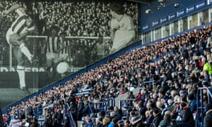 A photo Cyrille Regis graces the East Stand of the Hawthorns, where thousands gathered for his memorial service.