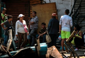 Locals sit on the street during the blackout in Maracaibo.