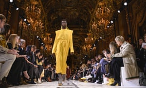 A model wears a shirt dress with architectural shoulders at the Stella McCartney show in Paris