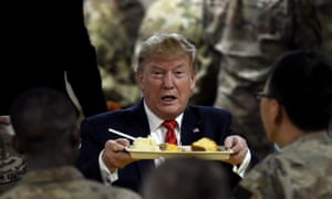 Trump serves Thanksgiving dinner to troops at the Bagram airbase near Kabul.