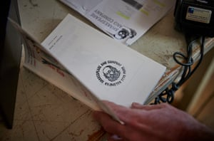 A staff member stamps a book