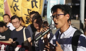 Eddie Chu and followers demonstrate against the arrest of 26 people opposed to the Chinese government.