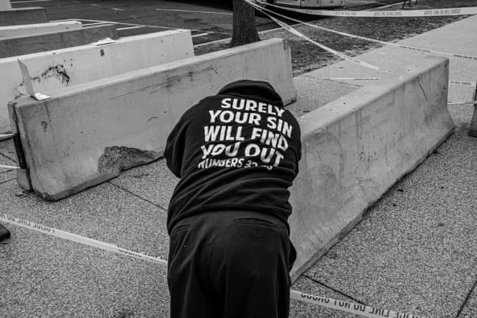 A Christian protester rests against a security barrier on Wednesday.