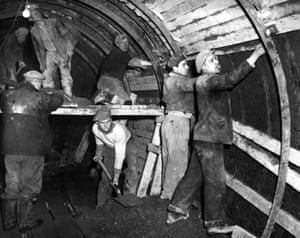 March 1950. Pictured, workers prepare the tunnels for tiling
