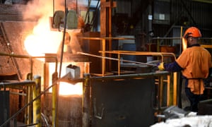 Workers are seen with molten metal at a foundry at Backwell IXL manufacturing facility in Geelong