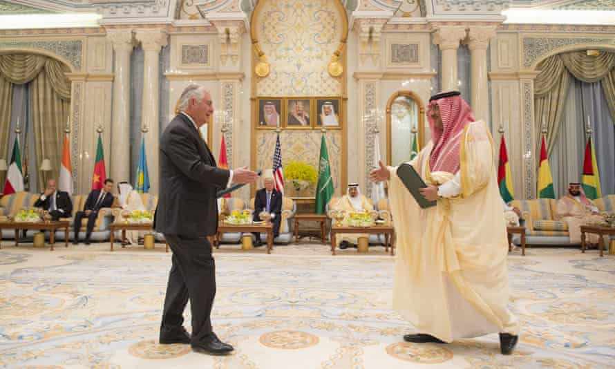 Rex Tillerson and Crown Prince of Saudi Arabia Muhammad bin Nayef shake hands after signing an agreement in Riyadh on 21 May 2017.