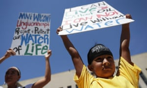 Omaka Nawicakinciji of the Oglala Lakota Nation in South Dakota participates with his mother Heather Mendoza during a rally on the Dakota Access Pipeline.